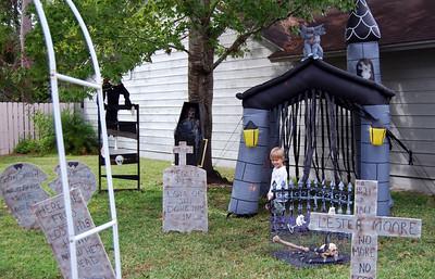 16 Neighbor expert examining the Halloween yard