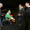 Richard Hamelin, 75, of Dracut, takes his daughter Kathy, 49, trick-or-treating for the 45th year around their neighborhood. Kathy has cerebral palsy. Kathy Hamelin admires the shoes of Colleen Davis of Dracut. Davis and her fiance Conrad Leclair of Dracut were helping pass out candy at a freind's house. (SUN/Julia Malakie)