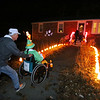 Richard Hamelin, 75, of Dracut, takes his daughter Kathy, 49, trick-or-treating for the 45th year around their neighborhood. Kathy has cerebral palsy. (SUN/Julia Malakie)