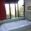 Our chalet's bathroom at Three Tree - a view over Spioenkop
