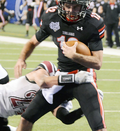 Will Fehlinger | The Herald-Tribune<br /> East Central junior quarterback Alex Maxwell scores the game-winning touchdown Nov. 25 in Indianapolis to secure the second state title in school history.
