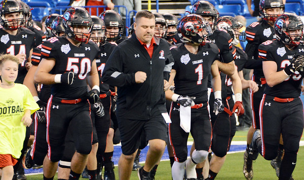 Photos by Will Fehlinger | The Herald-Tribune<br /> <br /> Head coach Justin Roden leads the East Central Trojans into Lucas Oil Stadium prior to the Class 4A state championship game vs. Lowell.