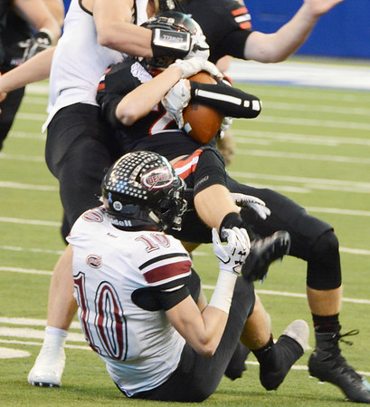 Will Fehlinger | The Herald-Tribune<br /> Wide receiver Matt Lewis is wrestled down by Lowell defenders after picking up a key first down for East Central in the 4A state championship game.