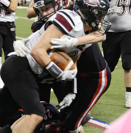 Will Fehlinger   The Herald-Tribune<br /> <br /> East Central's Nathan Lloyd stops a Lowell carry in action from the Class 4A state championship game Nov. 25. Lloyd had key interceptions at the end of each half in EC's 14-7 win.