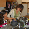 Alana helps me pour out grapeleaves juice for transport Easter morn.