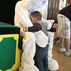 Peter Cottontail made a special guest appearance at City Hall on Thursday. The 4-H supplied real, live rabbits for kids to ogle and pet. There was coloring for young ones as well. Mason Cintron, 2, gives Peter Cottontail a big hug during the event. SENTINEL & ENTERPRISE/JOHN LOVE