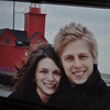 Laura + Chris pictured in front of Big Red in Holland, MI.  It was a frigid day, they didn't have warm enough clothing, but the picture is gorgeous.  Picture was taken a couple years ago and in their apartment now.  Wonderful, but chilly memories