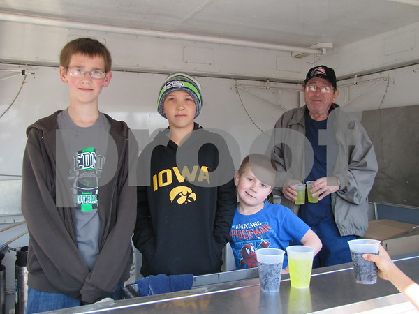 Michael and Matt Kuhn, Nate Spencer, and Micheal Spencer served pop at the Easter Egg Hunt.  Use of the trailer was donated by Dominos Pizza.