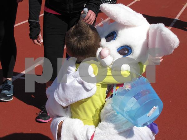 Brecken Kokenge gives the Easter Bunny a hug.