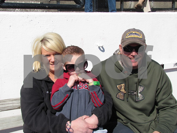 Angie and Tucker Gill, and Lonnie Gopfert