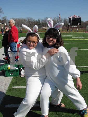 Bethany Grazier and Kennadie Machovec were 'bunny' helpers at the annual Easter Egg Hunt.