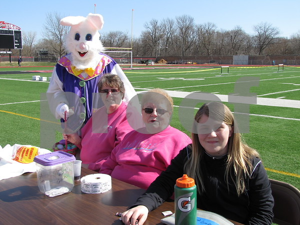 "Cleo Abel ""Bunny"", Ann Mahovec, Pat Scheer, and Riley Nelson sell tickets to children at the Easter Egg Hunt."