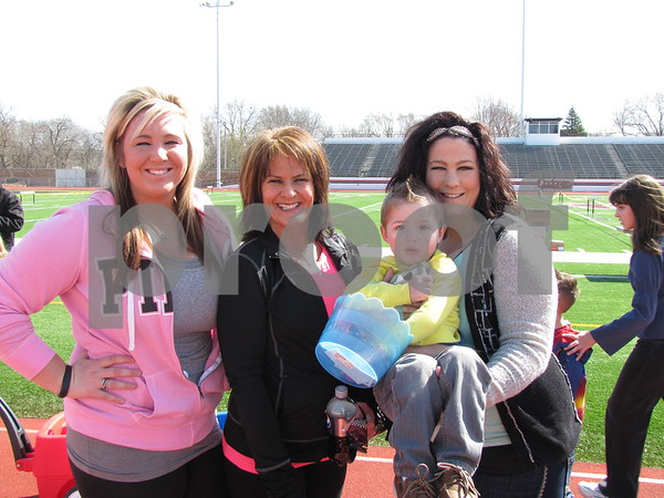 Emily Grell, Kathy Grell, and Erica Grell holding Brecken Kokenge.