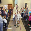Crossroads Community Church in Fitchburg had an interactive easter experience for the children featuring a live camel and donkey. Part of the interactive event Youth Paster Tim St. Jean of Fitchburg rides in on a donkey as Jesus riding into Jerusalem. SENTINEL & ENTERPRISE/JOHN LOVE