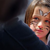 Fitchburg State University had its annual community egg hunt on the campus' main quadrangle on Saturday. Getting her face painted at the event is Maryle Hooper, 7. SENTINEL & ENTERPRISE/JOHN LOVE