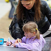 Fitchburg State University had its annual community egg hunt on the campus' main quadrangle on Saturday.  Doing some coloring together at the event is Elena Medvedeva and her daughter Taisiya, 6, from Gardner. SENTINEL & ENTERPRISE/JOHN LOVE