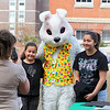 Fitchburg State University had its annual community egg hunt on the campus' main quadrangle on Saturday.  Jennifer Pellecchia takes a pictue of Hannah Millan, 8, and Nicole Millan, 14, during the event with the Easter Bunny. SENTINEL & ENTERPRISE/JOHN LOVE