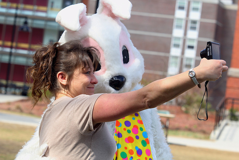 Fitchburg State University had its annual community egg hunt on the campus' main quadrangle on Saturday.  Taking a selfie with the easter bunny Jennifer Pellecchia at the event. SENTINEL & ENTERPRISE/JOHN LOVE