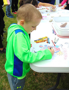 Diane Raver | The Herald-Tribune J.J. Hountz, 5, colored a picture at one of the activity stations.