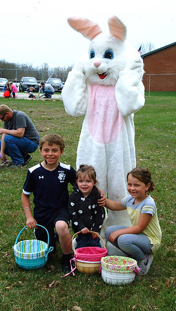 Diane Raver | The Herald-Tribune<br /> Billy, Tiffany and Allie Cox posed with the Easter Bunny.