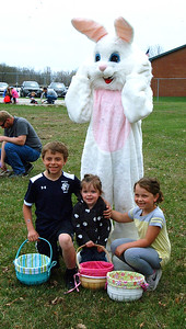 Diane Raver   The Herald-Tribune Billy, Tiffany and Allie Cox posed with the Easter Bunny.