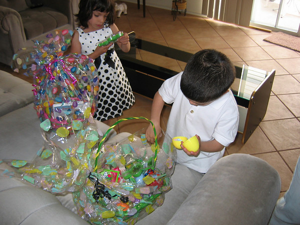 The twins opening one of their many Easter baskets