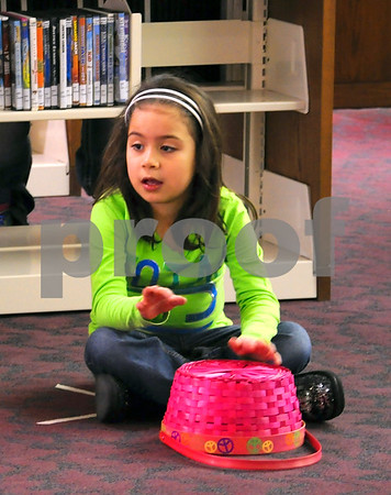 -Messenger photo by Joe Sutter<br /> <br /> Kennedie Davalos, 6, drums on her easter egg basket, thinking about all the eggs she'll collect at the annual Smeltzer Family Easter Egg Hunt.