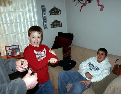 Travis Bisenius watching Bryce do some karate moves  ( 2005 )