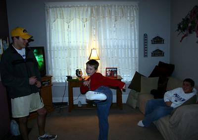 Cory and Travis Bisenius watching Bryce kick  ( 2005 )