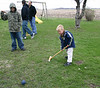 Wyatt hitting the Croquet ball while Bryce, Travis and Phil wait for their turn.  ( 2007 )