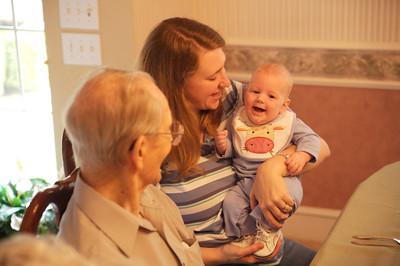 Mom and Robert giggle for Grandpa.