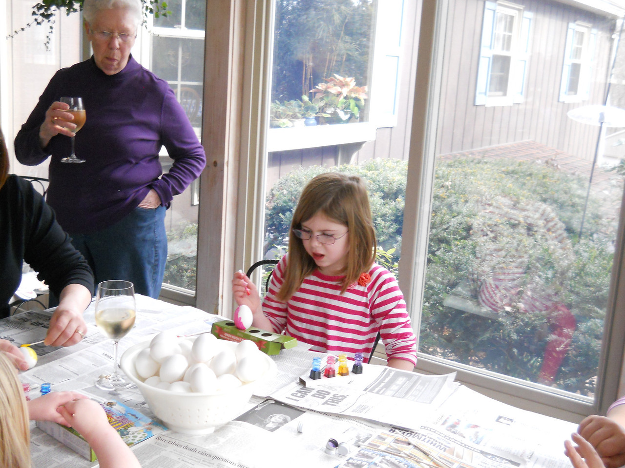 Nana looking on as Anna paints