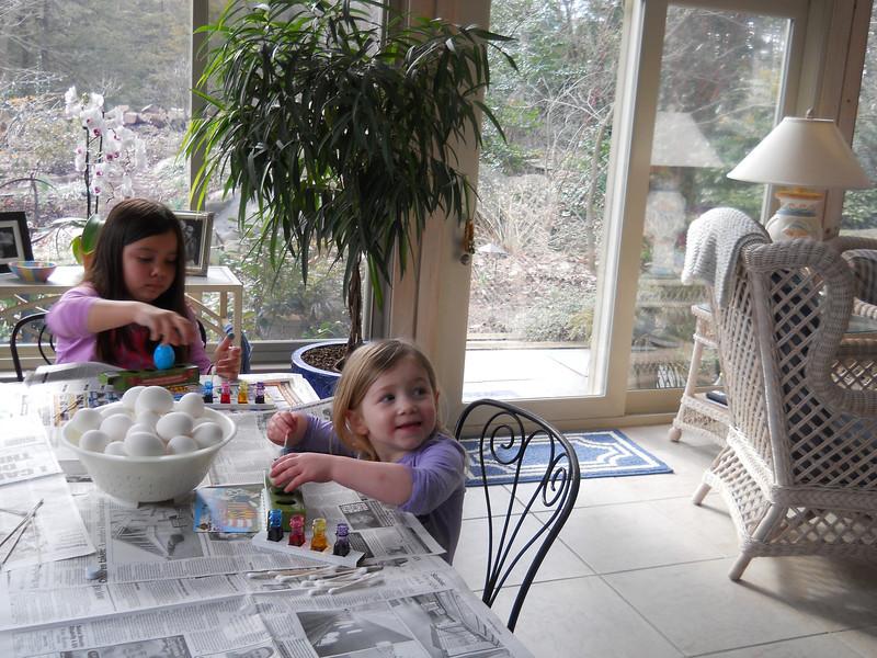 Kaidyn and Katrina painting Easter eggs