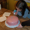 Scout decorating her dad's cake
