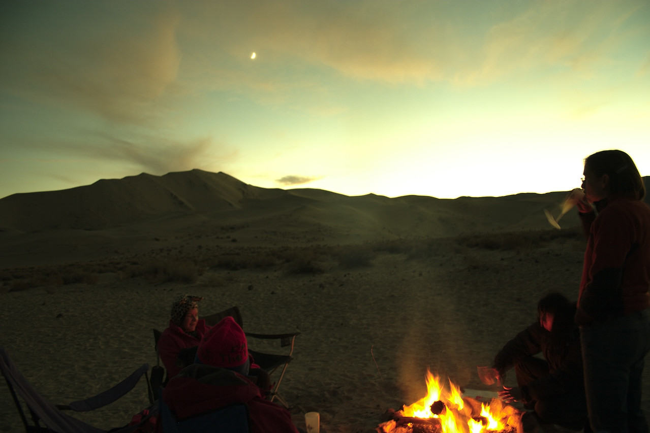 A campfire scene just after sunset.