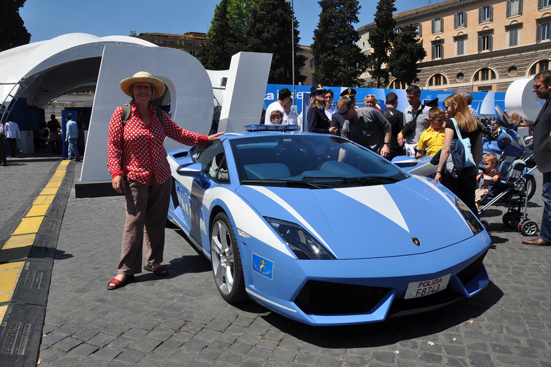 Sheila's thinking of making a quick getaway in this Italian police Ferrari