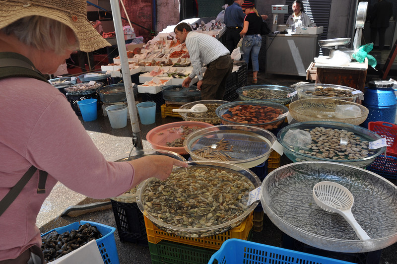 Naples fishmarket. All these large glass dishes contain fresh live seafood