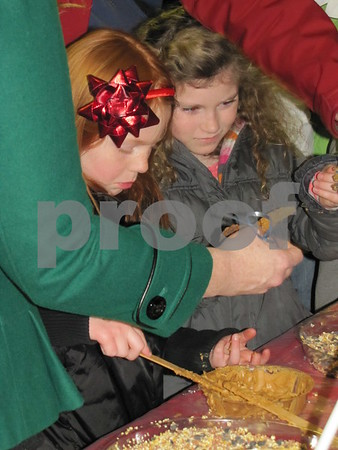 Emmersyn Peters and Pieper Elsberry make pinecone ornaments.