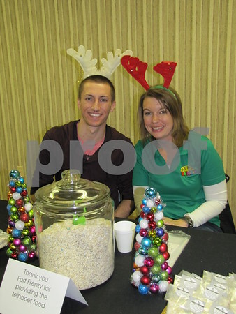 Joshua Lennon and Alli Berger of Fort Frenzy handed out 'reindeer food' to children at the tree lighting event.