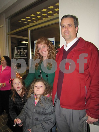 Adrianne Peters and Jim Oberhelman with Emmersyn Peters and Pieper Elsberry handed out candy canes at the Trolley Center.