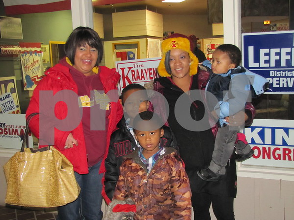 Angela Voight, Quantaze Jordan, Samantha Spencer holding Kyrie Spencer, and Kaveion Spencer (in front) are about to visit with Santa.