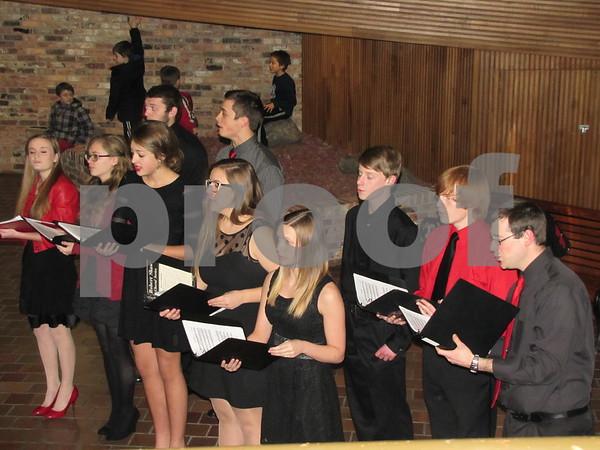 Members of the Fort Dodge Senior High Acapella Choir sang songs of the season.