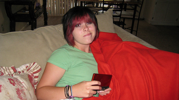 Chelsea killing time with her Nintendo DS