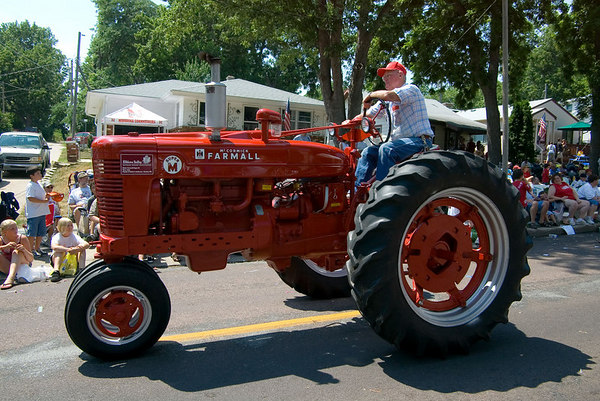 "<font size=""3"">These guys spend a lot of time making the old tractors look new again.</font>"