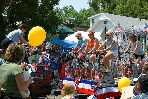 "<font size=""3"">My vote for strangest float of the day.  A spinning class atop a flatbed trailer.</font>"
