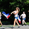 Debbie Blank | The Herald-Tribune<br /> Milan High School Band flag members follow musicians in the procession.
