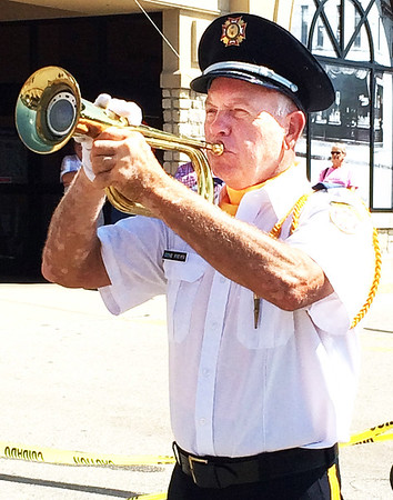 "Debbie Blank | The Herald-Tribune<br /> VFW member and Vietnam veteran Eugene Freyer, Sunman, played ""Taps"" to conclude the VFW Day ceremony."
