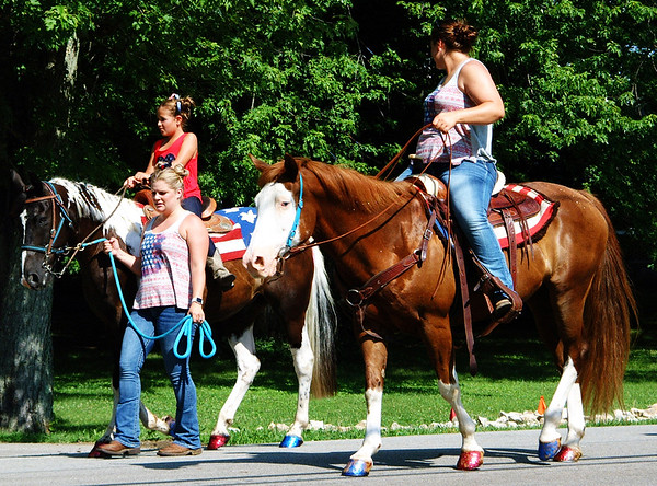 Debbie Blank | The Herald-Tribune<br /> Horses and their riders concluded the Milan event. Notice the animals' patriotic hooves.