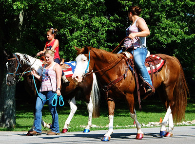Debbie Blank | The Herald-Tribune Horses and their riders concluded the Milan event. Notice the animals' patriotic hooves.