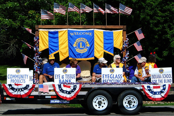 Debbie Blank | The Herald-Tribune<br /> Milan Lions organized the parade. Their float explained how members make a different at local, state, national and international levels.